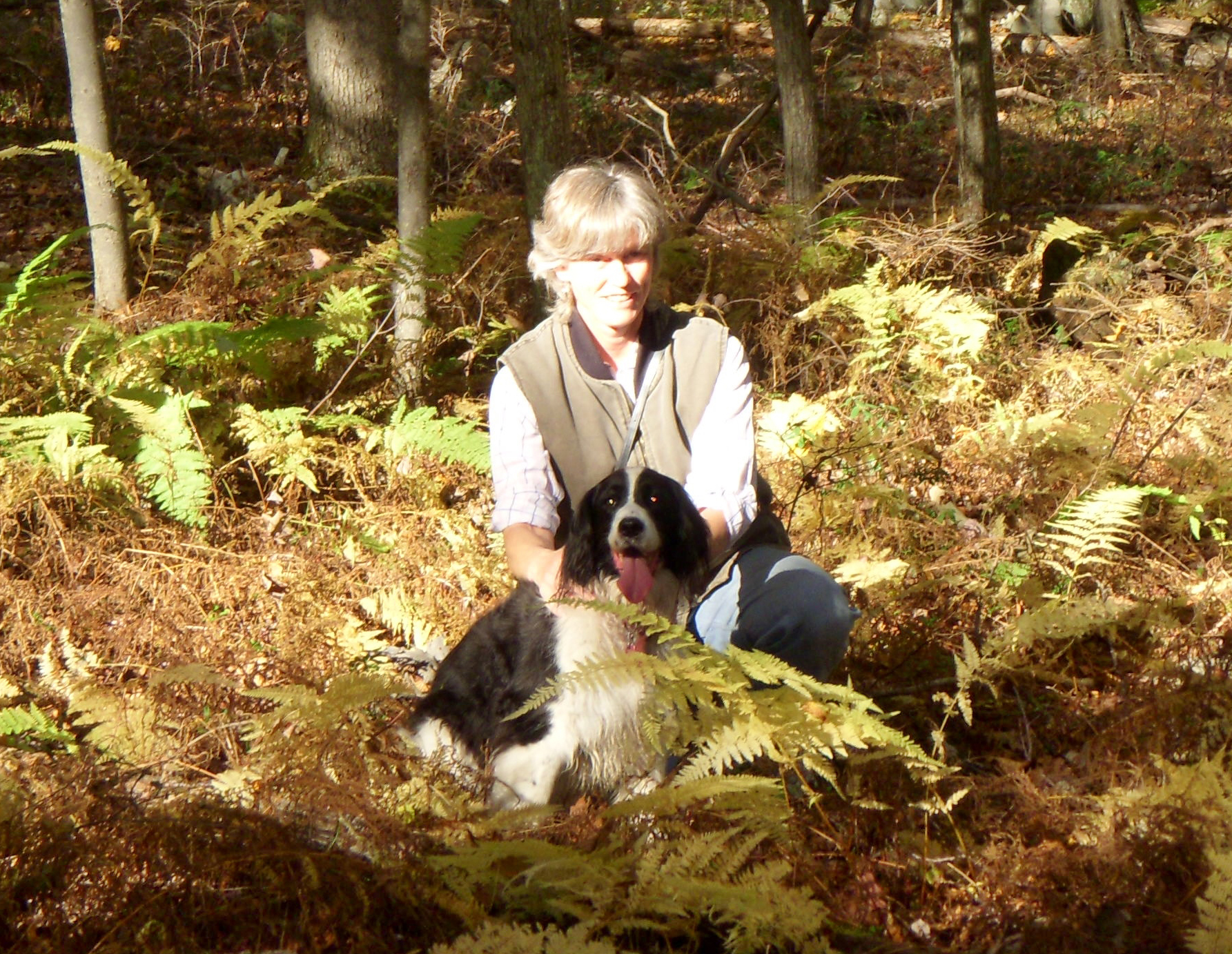 Woman and her dog in the woods