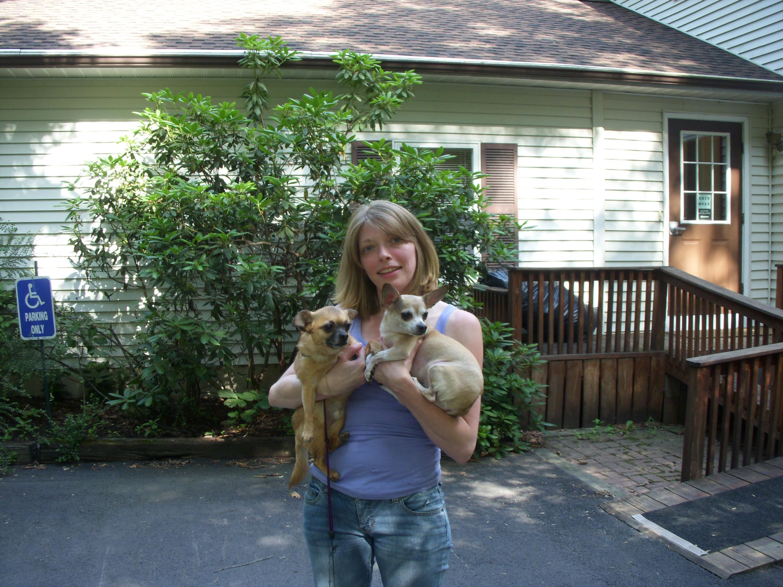 Woman holding her two dogs